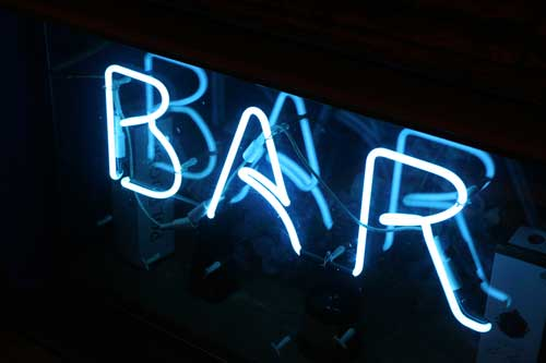 Neon sign spelling B A R